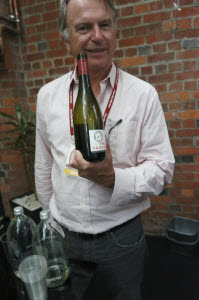 Actor Sam Neill showing off his Two Paddocks Pinot