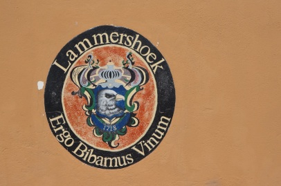 """Lammershoek crest and credo: """"Therefore, we drink wine"""""""