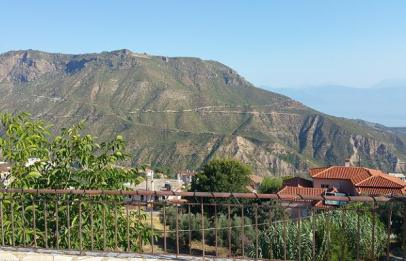 View of the mountains of Achaia from Tetramythos Winery and Homestay, Ano Diakopto of Aegialia, on the slopes of Mount Chelmos, Peloponnese