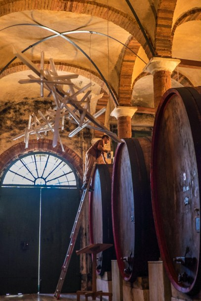 Topping up large old casks of sangiovese